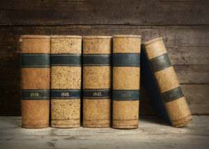 old bound books on vintage wooden background